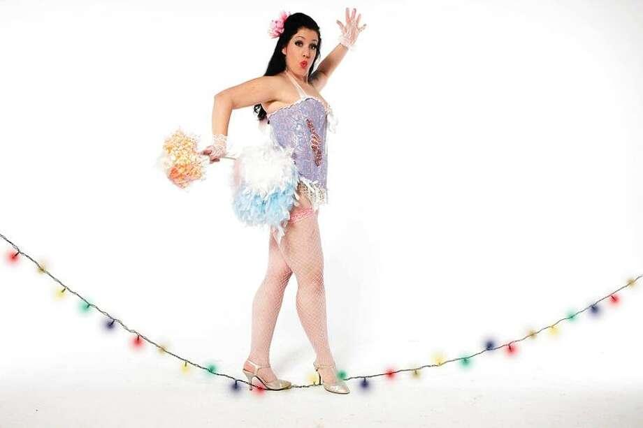 Billy Ryan photo: Burlesque queen Dot Mitzah starts the action. / BILLY RAAYN