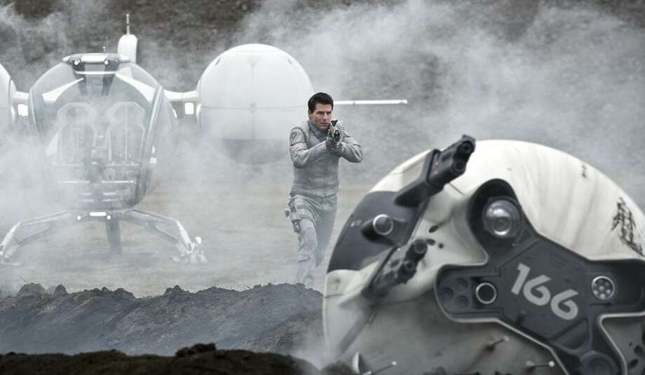 """Universal Pictures photo: Moviegoers will get a feeling they've seen this sci-fi flick before: Tom Cruise in """"Oblivion."""" Photo: AP / AP2012"""
