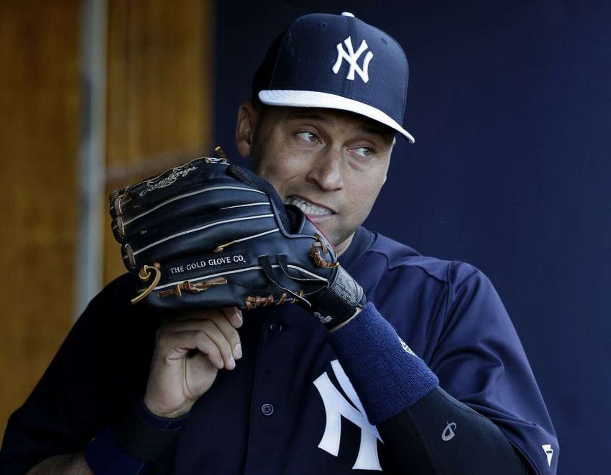 FILE - In this March 13, 2013, file photo, New York Yankees shortstop Derek Jeter adjusts the laces on his glove before a spring training baseball game against the Philadelphia Phillies in Tampa, Fla. The Yankees said Thursday, April 18, 2013, that Jeter will be sidelined until after the All-Star break because of a new fracture in his injured left ankle. (AP Photo/Kathy Willens, File)