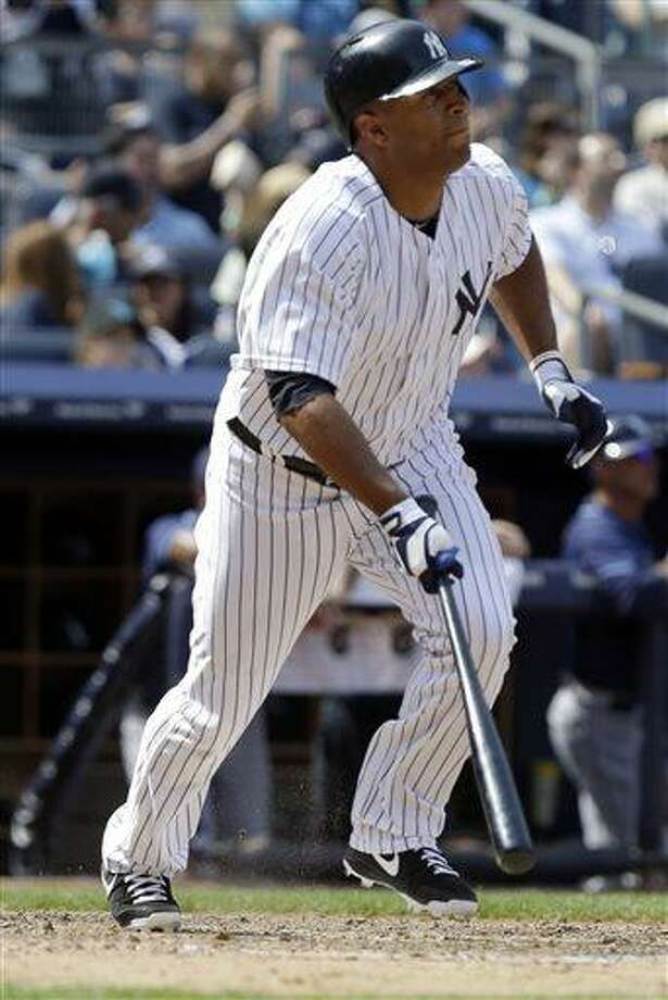 New York Yankees' Vernon Wells hits a ground-rule double to drive in three runs during the seventh inning of a baseball game against the Tampa Bay Rays Saturday, June 22, 2013, in New York. (AP Photo/Frank Franklin II) Photo: AP / AP