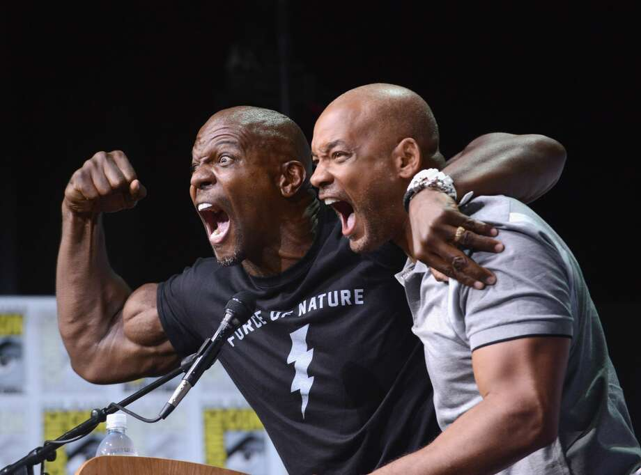 """Actors Terry Crews (left) and Will Smith pose onstage at Netflix Films: """"Bright"""" and """"Death Note"""" panel during Comic-Con International 2017 at San Diego Convention Center on July 20, 2017 in San Diego, California. Photo: Albert L. Ortega/Getty Images"""