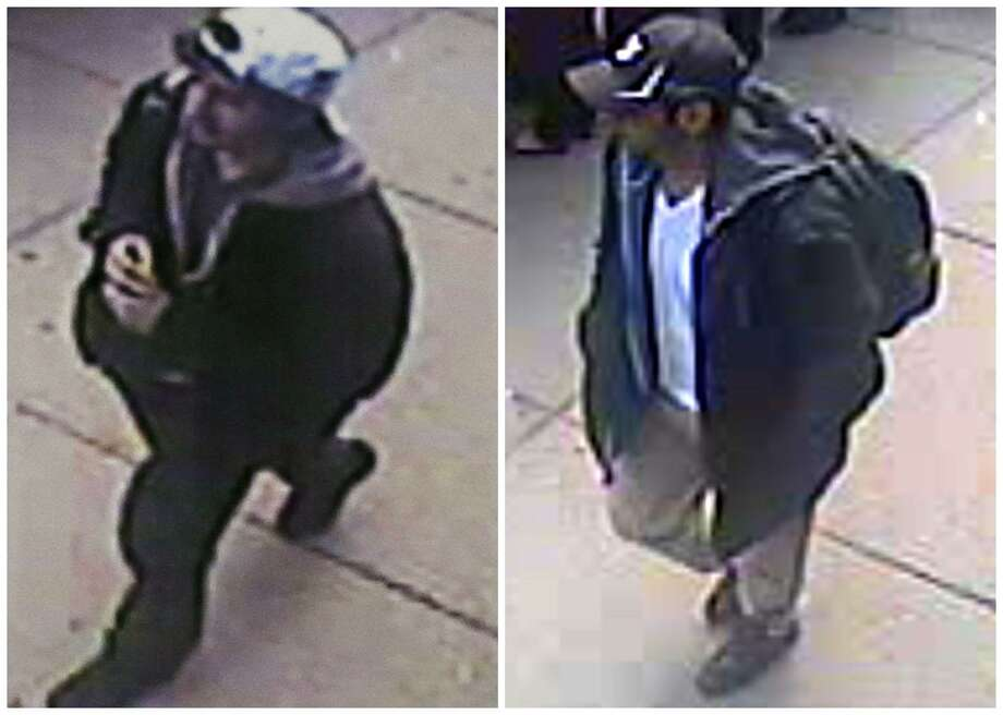 This combination of images released by the FBI on Thursday, April 18, 2013, show two images taken from surveillance video of who the FBI are calling suspect number 2, left, in white cap, and suspect number 1, right, in black cap, as they walk near each other through the crowd before the explosions at the Boston Marathon on Monday, April 15, 2013. (AP Photo/FBI) Photo: ASSOCIATED PRESS / THE ASSOCIATED PRESS2013