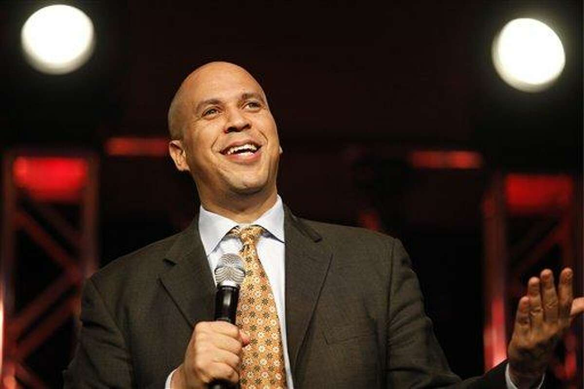 """Newark Mayor Cory Booker in speaks to around 800 people attending the Southwest Michigan First Catalyst 2013 in Kalamazoo, Mich. Booker's presentation was titled """"How to Change the World with your Bare Hands."""" (AP Photo/The Kalamazoo Gazette, ) ALL LOCAL TV OUT; LOCAL TV INTERNET OUT"""