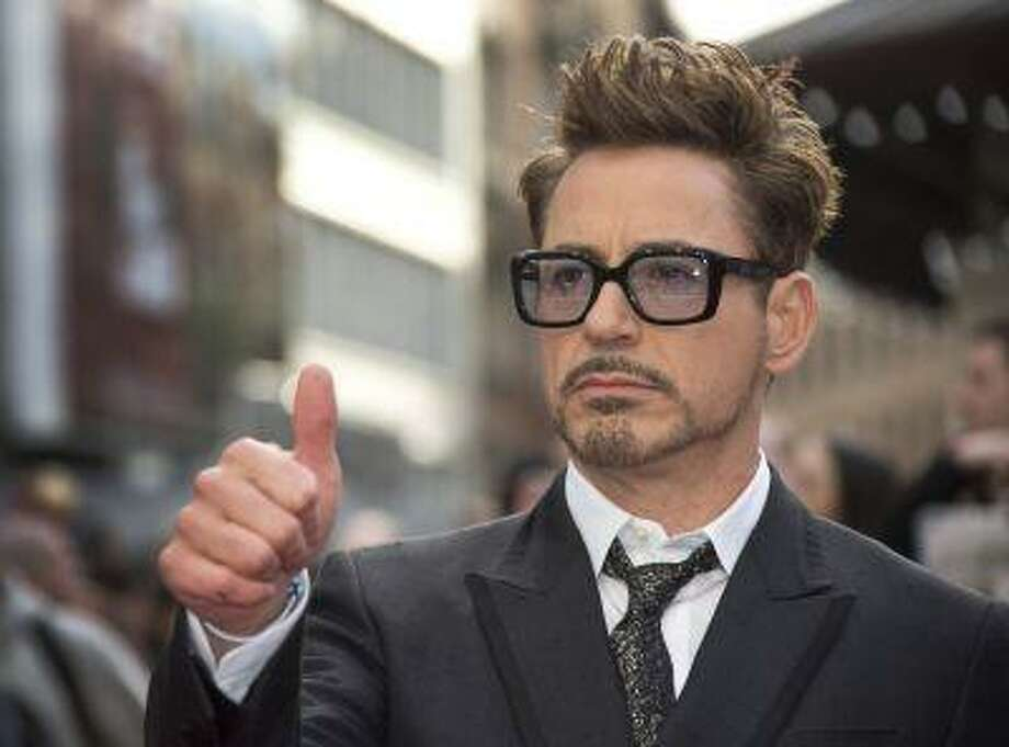 """FILE - This April 18, 2013 photo shows actor Robert Downey Jr at the UK premiere of """"Iron Man 3,"""" in central London. Marvel announced Thursday, June 20, that the actor will reprise his role as Iron Man/Tony Stark for both """"The Avengers 2"""" and """"The Avengers 3."""" Downey Jr. has played the character in a trilogy of """"Iron Man"""" films, as well as the first """"Avengers"""" film,"""" which made $2.7 billion worldwide. (Photo by Joel Ryan/Invision/AP, file) Photo: AP / Invision"""