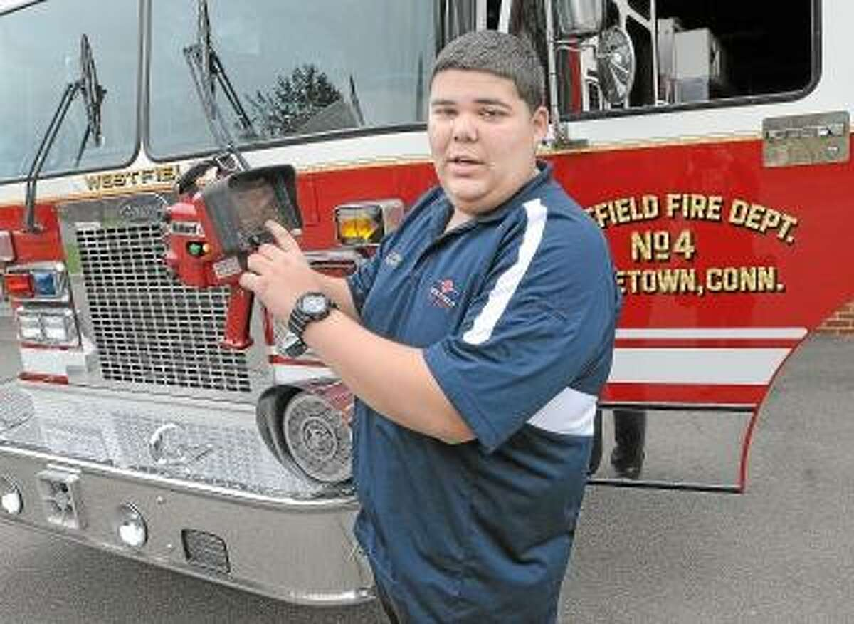 Catherine Avalone/The Middletown Press Westfield Fire Department firefighter James Figueroa explains how the Bullard TIx thermal imaging camera locates a heat signature. Westfield Fire Department will receive two new TIC's.