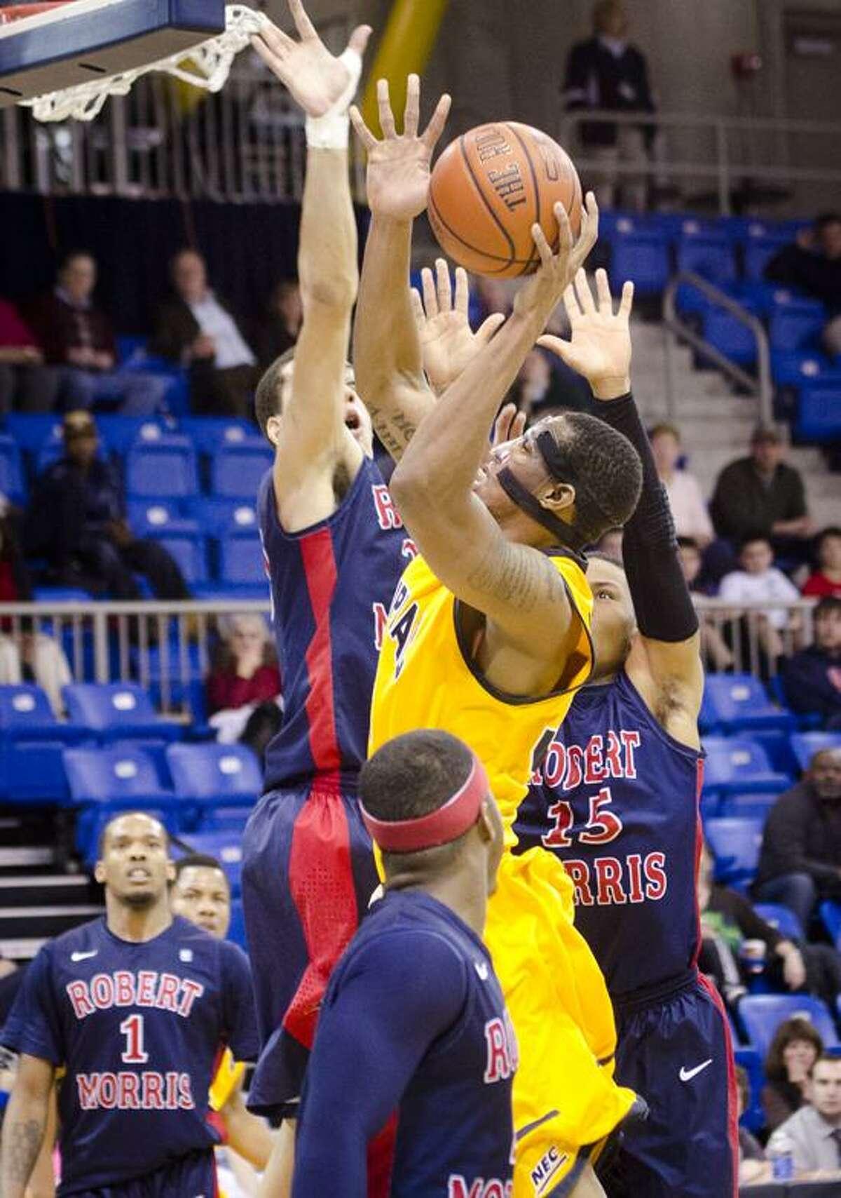 SPORTS-Quinnipiac vs. Morris Basketball Quinnipiac's Jamee Jackson goes to the basket in 2nd half actionMelanie Stengel/Register2/14/13