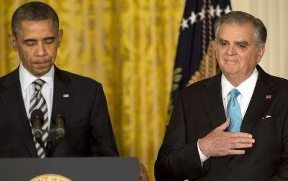 Transportation Secretary Ray LaHood, right, places his hand over his heart as President Barack Obama describes his service while announcing the nomination of Charlotte, N.C., Mayor Anthony Foxx, not pictured, to succeed LaHood, Monday, April 29, 2013, in the East Room of the White House in Washington. (AP Photo/Jacquelyn Martin) Photo: ASSOCIATED PRESS / AP2013