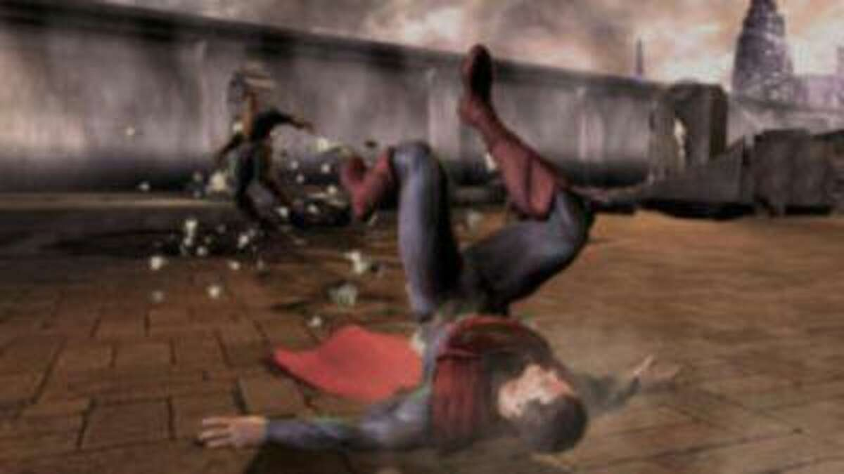 Black Adam, left, deals some damage to Superman in front of the Hall of Justice in
