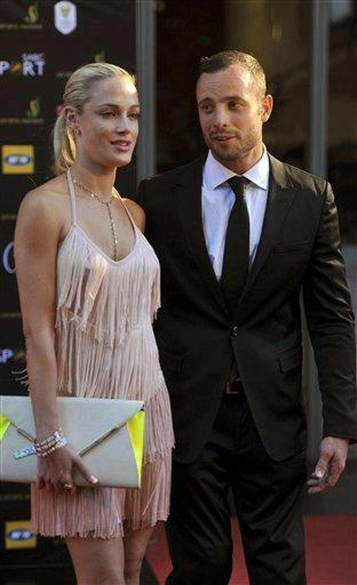 South African Olympic athlete Oscar Pistorius and Reeva Steenkamp, believed to be his girlfriend, at an awards ceremony, in Johannesburg, South Africa. Olympic athlete Oscar Pistorius was taken into custody and was expected to appear in court Thursday, Feb. 14, 2013, after a 30-year-old woman who was believed to be his girlfriend was shot dead at his home in South Africa's capital, Pretoria. AP Photo/Lucky Nxumalo-Citypress