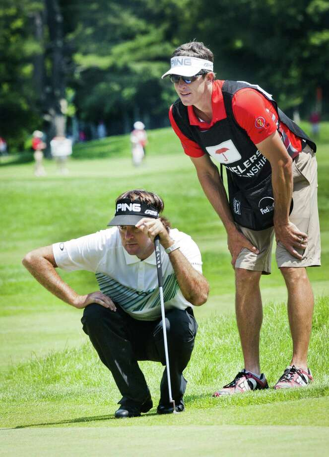 Melanie Stengel -- Register Bubba Watson and his caddy line up a putt on the 7th hole  6/21.