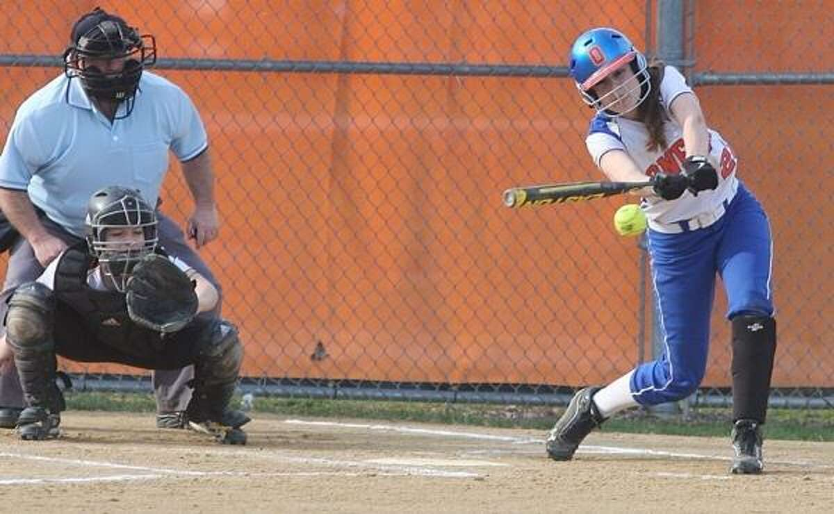PHOTO BY JOHN HAEGER @ ONEIDAPHOTO ON TWITTER/ONEIDA DAILY DISPATCH Oneida's Samantha Lusher (23) connects for a single as Canastota catcher Julia Collins looks on during the bottom of the fifth inning at Oneida on Thursday, April 18, 2013.