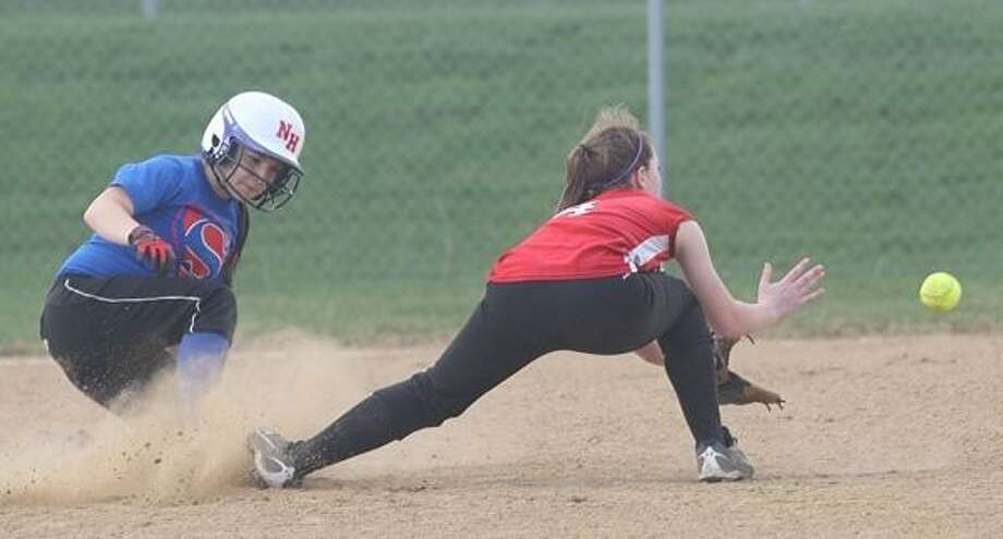 PHOTO BY JOHN HAEGER @ ONEIDAPHOTO ON TWITTER/ONEIDA DAILY DISPATCH New Hartford's Heather Badger (7) slides as she safely steals second as VVS' Gabby Brewster (4) awaits the throw during the top of the third inning at VVS on Thursday, April 18, 2013.