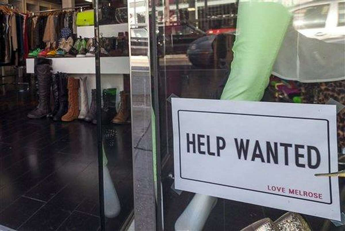 A help wanted sign is posted in December 2012 on the front window of a clothing boutique in Los Angeles. Associated Press file photo