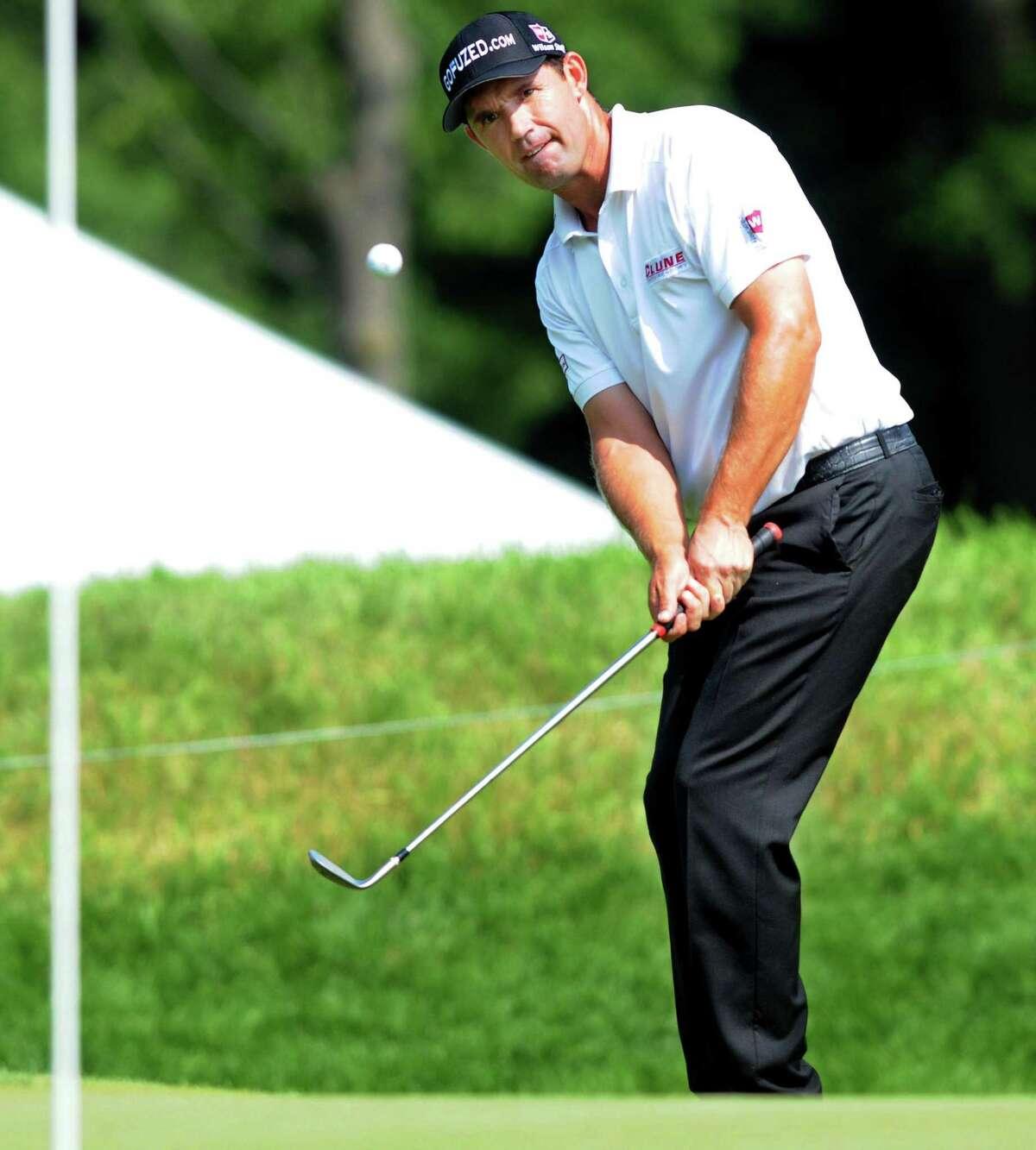 Mara Lavitt Ñ Register June 21, 2013: Travelers Championship golf at TPC River Highlands. Padraig Harrington. putting on 2.
