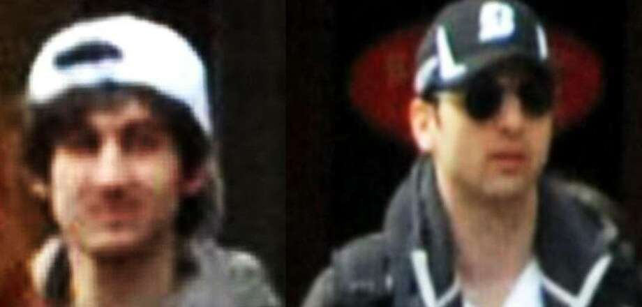 The left photo shows in a image from video what the FBI is calling suspect number 2 with a white hat, highlighted, walking in Boston on Monday, April 15, 2013, before the explosions at the Boston Marathon. The right photo shows in a image from video what the FBI is calling suspect number 1 with a black hat walking with a backpack. Photos released by the FBI.