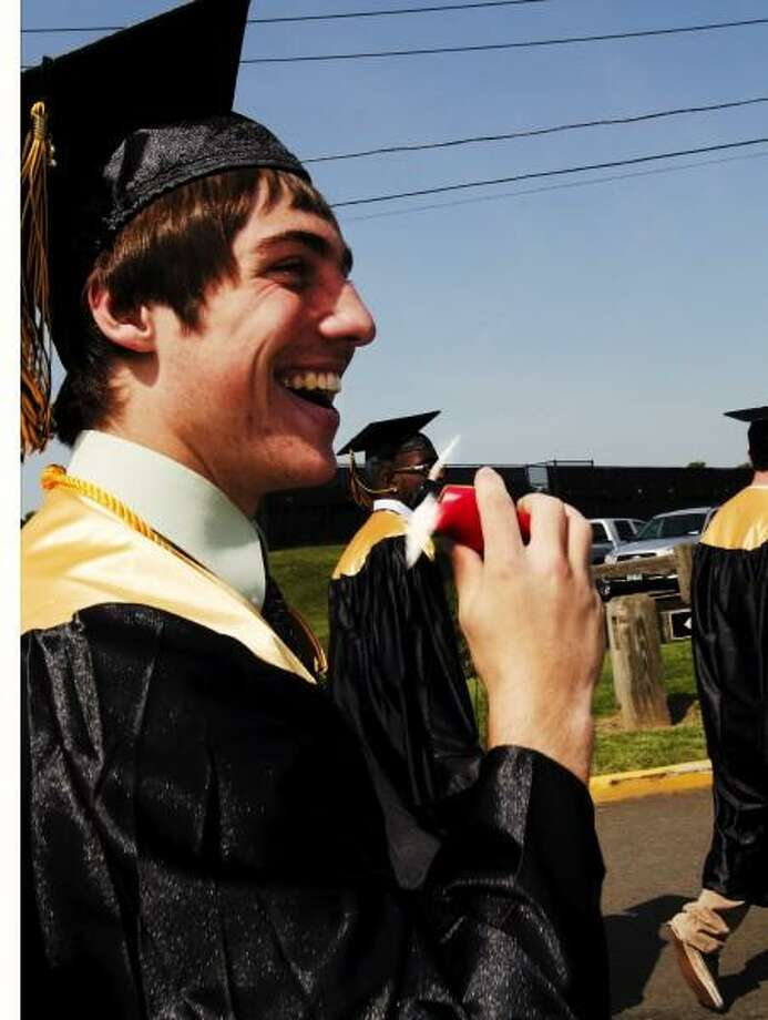 Melanie Stengel â?? Register      Graduating Amity senior, Ian Maier, keeps cool with a personal fan as he processes with his class to commencement ceremonies  on the Amity Football field.6/21.