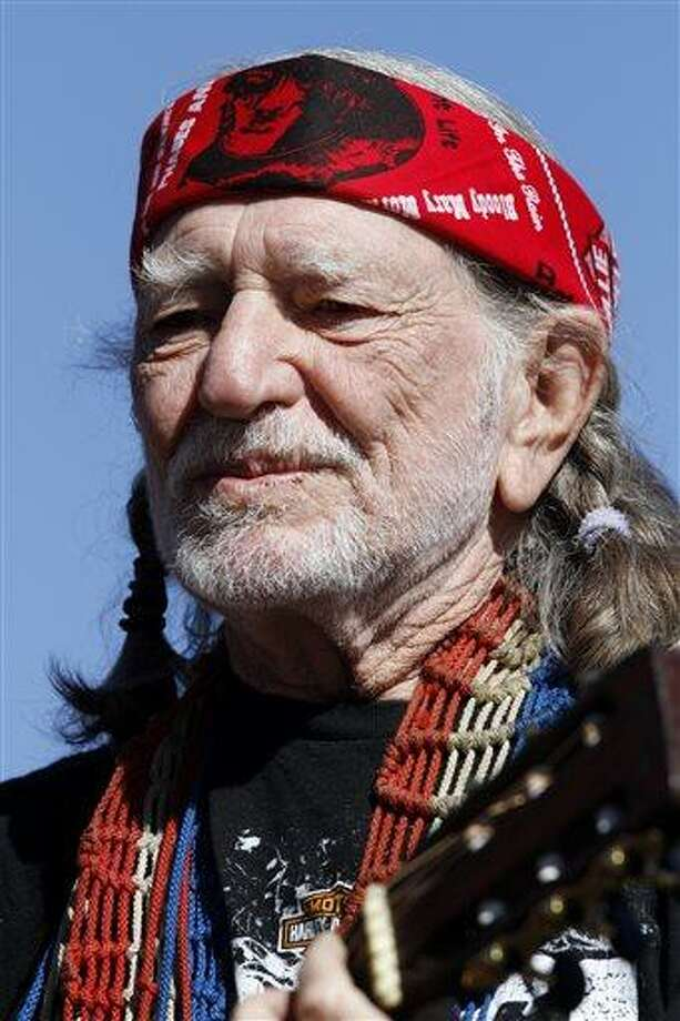 FILE - In this Nov. 7, 2010 file photo, Willie Nelson performs before the start of the NASCAR AAA Texas 500 auto race at Texas Motor Speedway, in Fort Worth, Texas. Nelson is sending out his prayers via Twitter Thursday April 18, 2013 after a deadly fertilizer plant explosion rocked West, Texas, a small community north of Waco near where he grew up. He was born and grew up 120 miles north of the state capital, in tiny Abbott, which is about five miles north of West. (AP Photo/Tim Sharp, File) Photo: AP / FR62992 AP