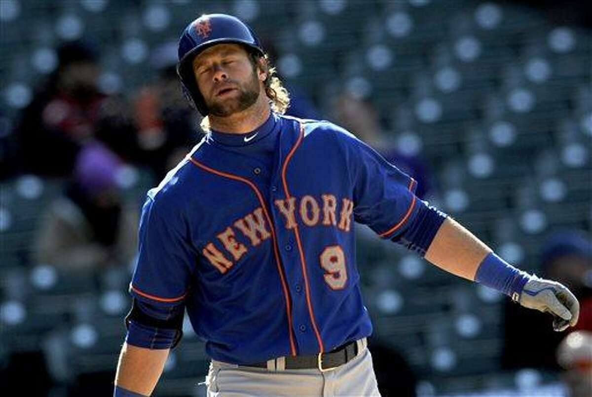 New York Mets' Kirk Nieuwenhuis (9) reacts to a strike during the ninth inning of a baseball game against the Colorado Rockies, Thursday, April 18, 2013, in Denver. The Rockies won 11-2. (AP Photo/Jack Dempsey)