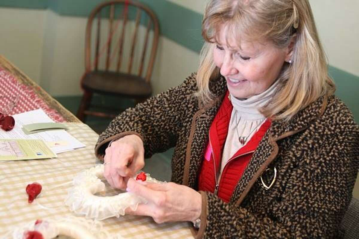 Dispatch Staff Photo by JOHN HAEGER twitter.com/oneidaphoto Sharon Stevens works on her valentine craft during a workshop at the Madison County Historical Society on Saturday Feb.9, 2013 in Oneida.