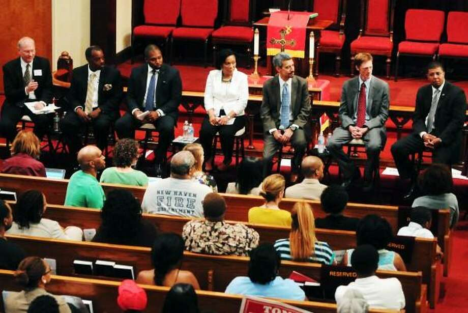 Peter Hvizdak â?? Register New Haven mayoral candidates debate at the Varick Memorial AME Zion Church in New Haven with democratic candidates, left to right, Matthew Nemerson, Sundiata Keitazulu, Gary Holder-Winfield, Toni Harp, Henry Fernandez, Justin Elicker and Kermit Carolina Friday evening June 21, 2013 Photo: New Haven Register / ©Peter Hvizdak /  New Haven Register