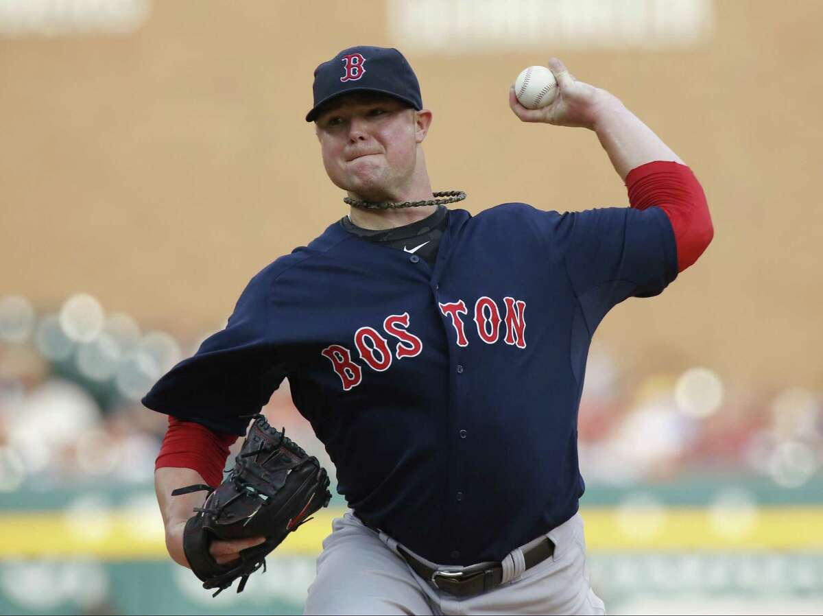 Boston Red Sox pitcher Jon Lester pitches against the Detroit Tigers in the first inning of a baseball game Friday, June 21, 2013 in Detroit. (AP Photo/Duane Burleson)