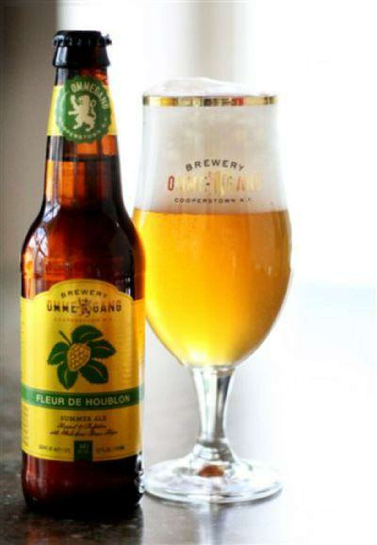 This undated publicity photo provided by Brewery Ommegang/Duvel Moortgat USA, shows a bottle and glass of Fleur de Houblon summer ale. (AP Photo/Brewery Ommegang/Duvel Moortgat USA)