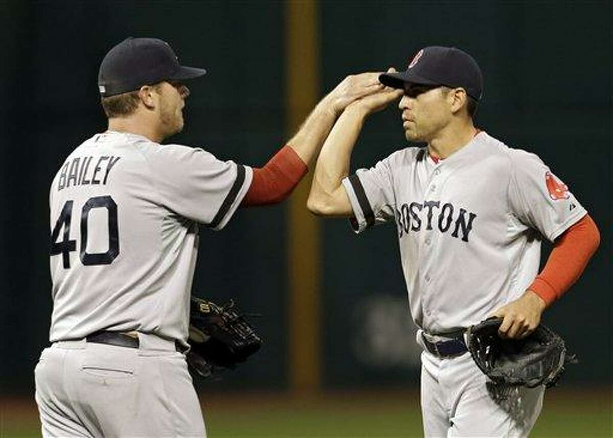 Boston Red Sox relief pitcher Andrew Bailey (40) celebrates with center fielder Jacoby Ellsbury after a 6-3 win over the Cleveland Indians in a baseball game on Thursday, April 18, 2013, in Cleveland. (AP Photo/Mark Duncan)