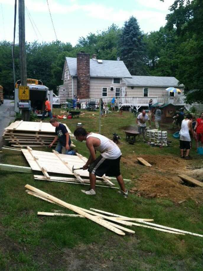 Volunteers from Green Bay, Wisconsin, help repair a home damaged by Hurricane Sandy in Old Saybrook last week. Funds from the United Way Hurricane Sandy Recovery Fund were used to make repairs not covered by FEMA or insurance.