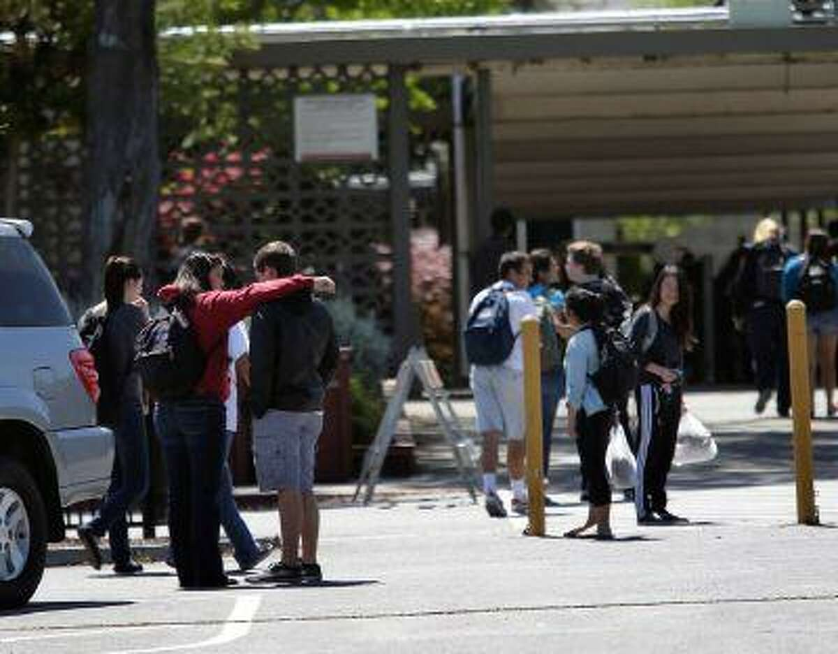 Students return to Saratoga High School following the lunch hour in Saratoga, Calif., on Friday, April 12, 2013. (Gary Reyes/Bay Area News Group)