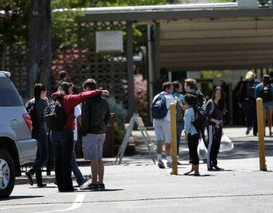 Students return to Saratoga High School following the lunch hour in Saratoga, Calif., on Friday, April 12, 2013. (Gary Reyes/Bay Area News Group) Photo: San Jose Mercury News / San Jose Mercury News