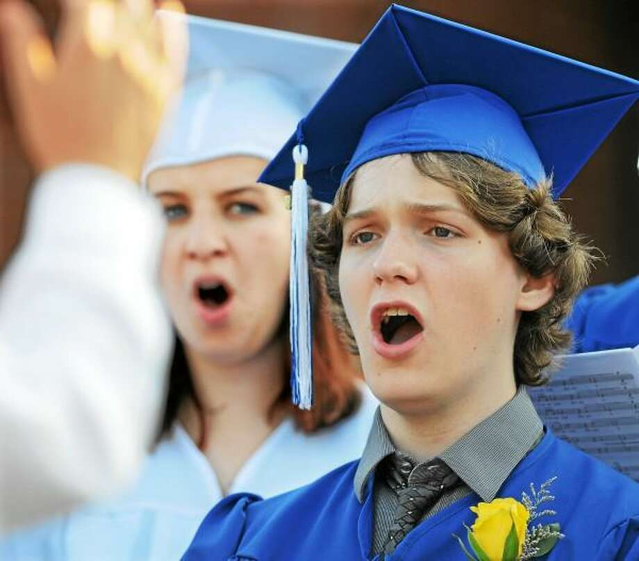 "Catherine Avalone/The Middletown Press Kevin Serra and Cara Burke, members of the class of 2013 Chamber Choir sing ""Shenandoah"" by Darmon Meader during East Hampton High School commencement exercise Friday evening. / TheMiddletownPress"