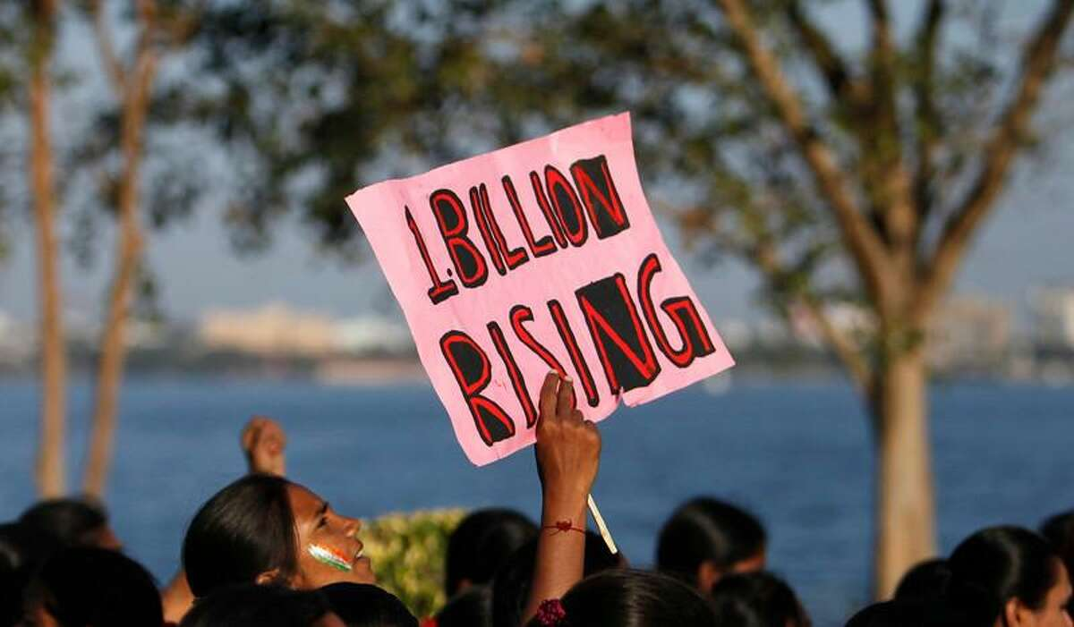 """Women participate in an event to support the """"One Billion Rising"""" global campaign in Hyderabad, India, Thursday, Feb. 14, 2013. Thousands of women and children in various cities in the country danced in the streets, in malls and other places to express support for the One Billion Rising movement, a worldwide call to end violence against women and girls. (AP Photo/Mahesh Kumar A.)"""