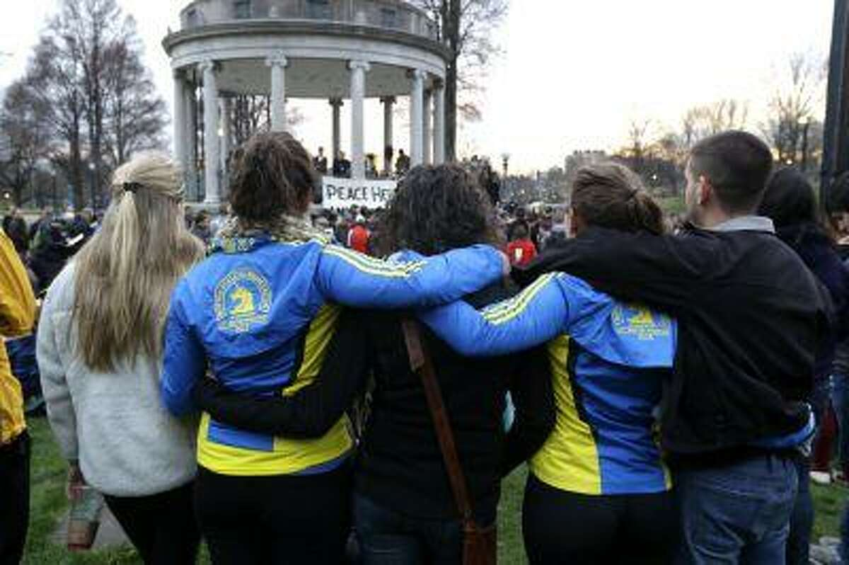 People congregate at Boston Common for a vigil for the victims of the Boston Marathon explosions, Tuesday, April 16, 2013, one day after bombs exploded at the finish line of the Boston Marathon. (AP Photo/Julio Cortez)