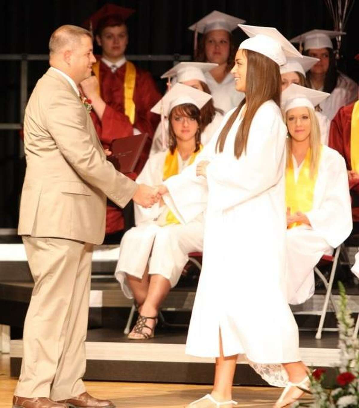 JOHN HAEGER @ONEIDAPHOTO ON TWITTER/ONEIDA DAILY DISPATCH Mariah Beauvais shakes the hand of Jacob Byron Board of Education President after receiving her diploma during 85th commencements at SVCS on Friday, June 21, 2013 in Munnsville.