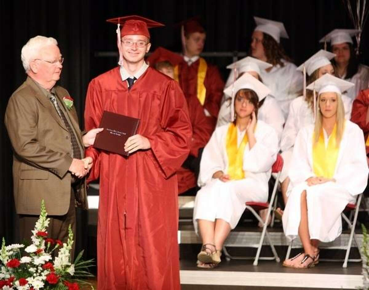 JOHN HAEGER @ONEIDAPHOTO ON TWITTER/ONEIDA DAILY DISPATCH Cody Collins poses with Interim Superintendent Dr. Patrick Curtin after receiving his diploma during 85th commencements at SVCS on Friday, June 21, 2013 in Munnsville