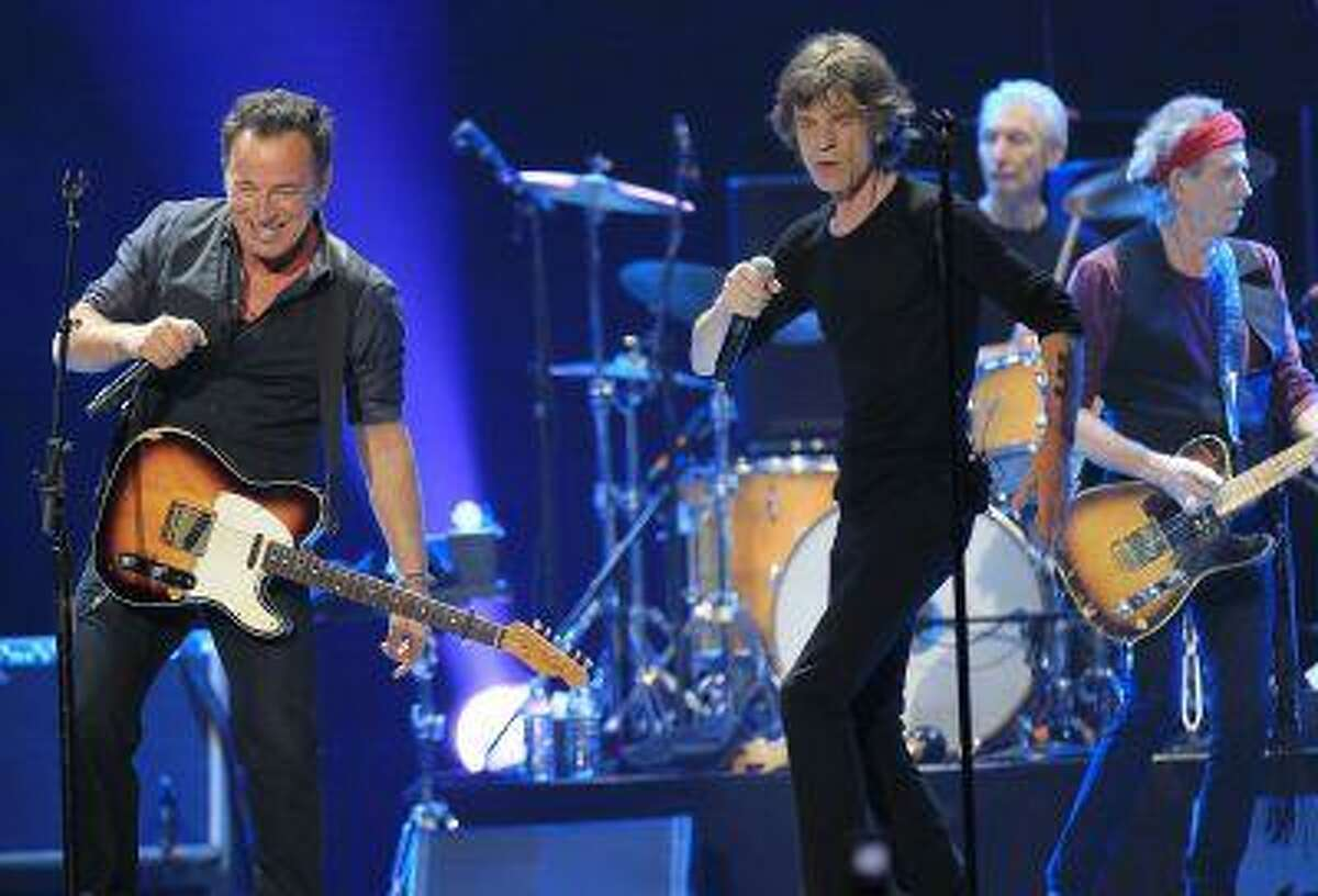 """Mick Jagger (R) and Bruce Springsteen perform onstage during the Rolling Stones final concert of their """"50 and Counting Tour"""" in Newark, N.J., December 15, 2012."""