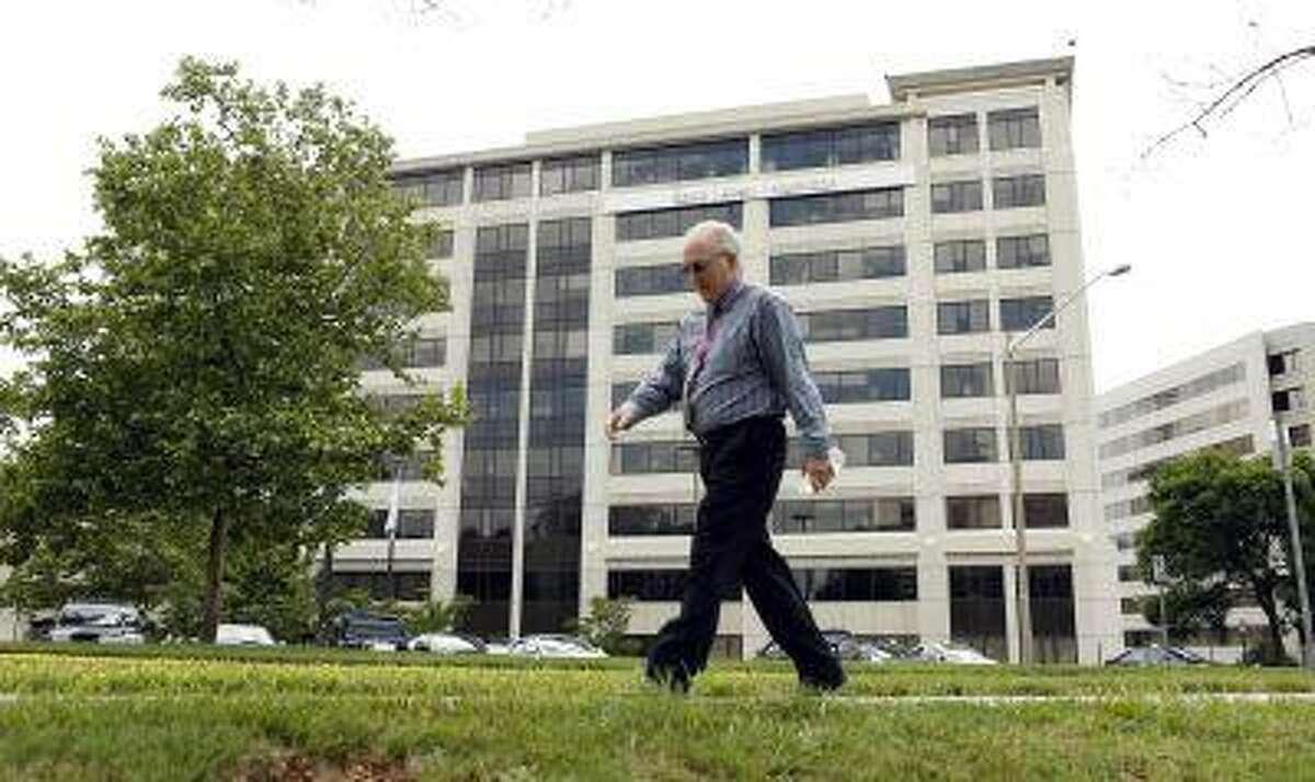 A man walks pass the Booz Allen Hamilton Holding Corp building in McLean, Va., on June 11, 2013.