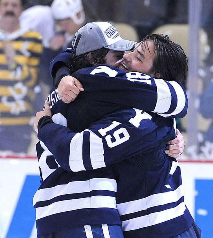 Kenny Agostino, left, hopes to have a reason to  celebrate again next year at Yale as he said  Tuesday he will return to school for his senior season. Peter Casolino/Register