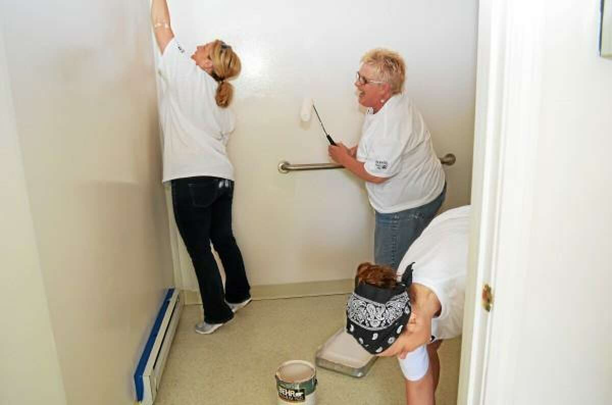 Jenny Golfin-Register Citizen - Volunteers from Northwest Community Bank and Connecticut Mutual Holding Company spent the day painting several rooms at Catholic Charities, 132 Grove St., Torrington.