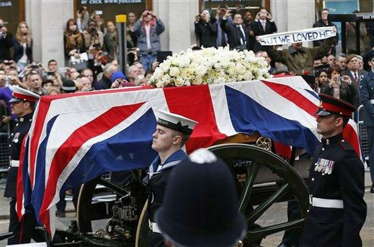 A Union flag draped coffin bearing the body of former British Prime Minister Margaret Thatcher is carried on a gun carriage drawn by the King's Troop Royal Artillery during her ceremonial funeral procession in London, Wednesday, April 17, 2013. The Iron Lady is being laid to rest - yet even in death, she remains a divisive figure. World leaders and dignitaries from 170 countries are to attend the funeral of former British Prime Minister Margaret Thatcher on Wednesday, an elaborate affair with full military honors that will culminate with a service at St. Paul's Cathedral in London. (AP Photo/Matt Dunham, Pool)