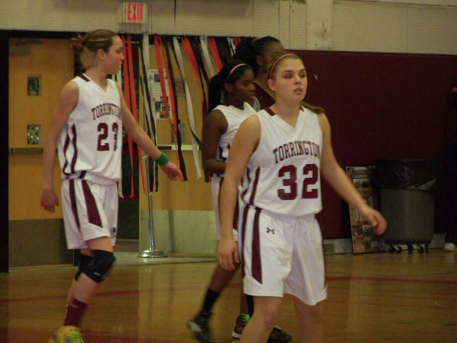 Torrington's Mia Barbieri, Mika Howard and Taylor How wait for Sacred Heart as they makes their way down the court on offense. Photo by Peter Wallace/Register Citizen