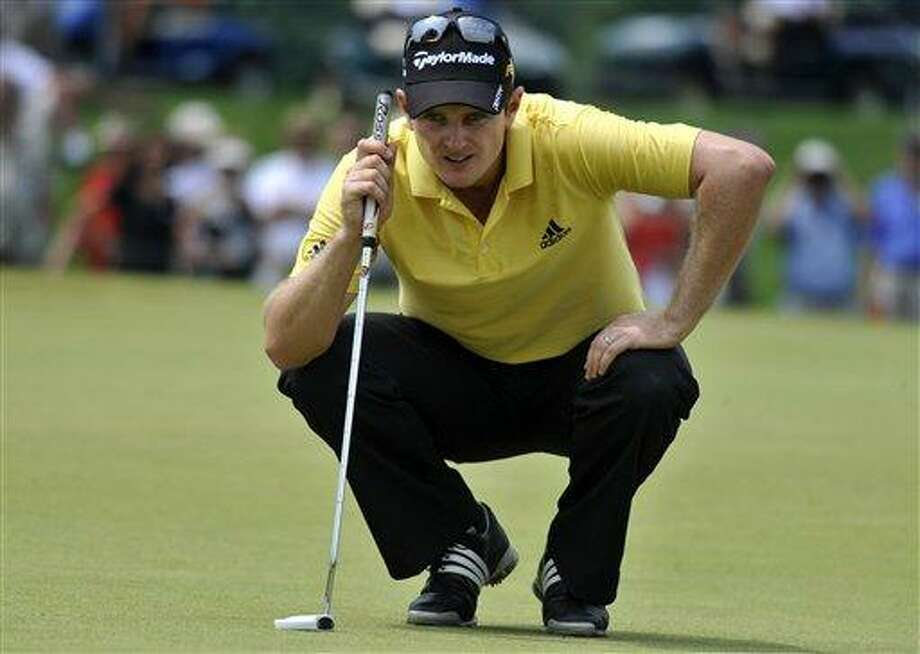 Justin Rose, of England, lines up a putt on the second hole during the final round of the Travelers Championship golf tournament on Sunday, June 27, 2010, in Cromwell, Conn. (AP Photo/Jessica Hill) Photo: ASSOCIATED PRESS / AP2010