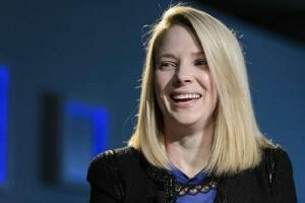 Marissa Mayer, Chief Executive Officer of Yahoo!, smiles during the 43rd Annual Meeting of the World Economic Forum, WEF, in Davos, Switzerland, Friday, Jan. 25, 2013. (AP Photo/Keystone/Laurent Gillieron)