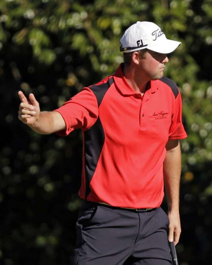 Marc Leishman reacts after making par on the 11th hole during the third round of the Masters golf tournament Saturday. He finished tied for fourth place and is the defending champion at the Travelers Championship. (AP Photo/Matt Slocum) Photo: AP / AP2013