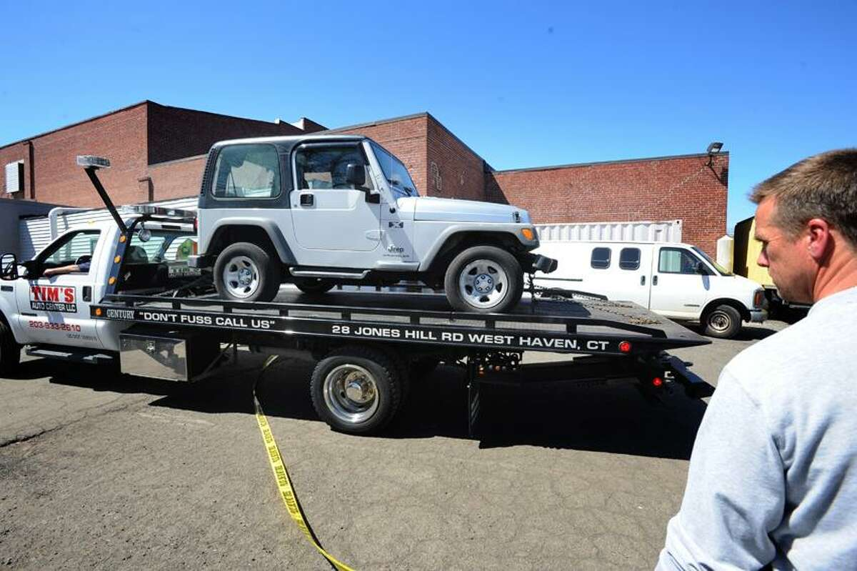 A vechicle related to the West Haven police investigation of an alleged drug lab at Mini Max Space Self Storage at 445 Front Rd in West Haven is towed from the scene April 17, 2013. vm Williams
