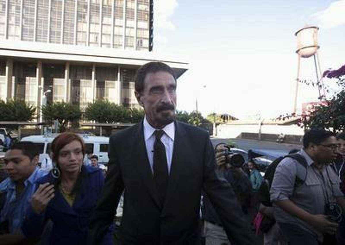 John Mcafee, anti-virus software guru, arrives for a news conference outside of the Supreme Court of Justice in Guatemala City, December 4, 2012