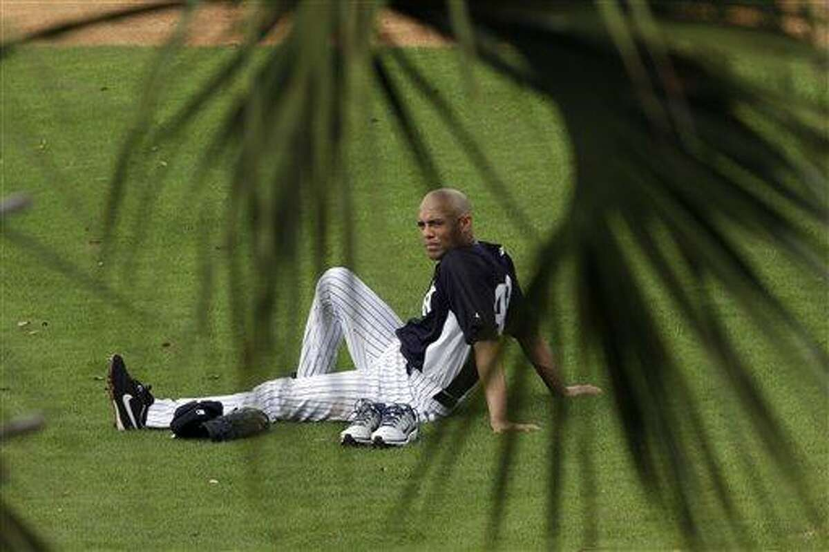 New York Yankees' Mariano Rivera rests after a workout at baseball spring training, Wednesday, Feb. 13, 2013, in Tampa, Fla. (AP Photo/Matt Slocum)