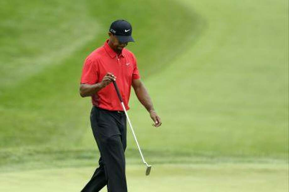 Tiger Woods reacts to a missed putt on the fourth hole during the fourth round of the U.S. Open golf tournament at Merion Golf Club, Sunday, June 16, 2013, in Ardmore, Pa. Photo: ASSOCIATED PRESS / AP2013