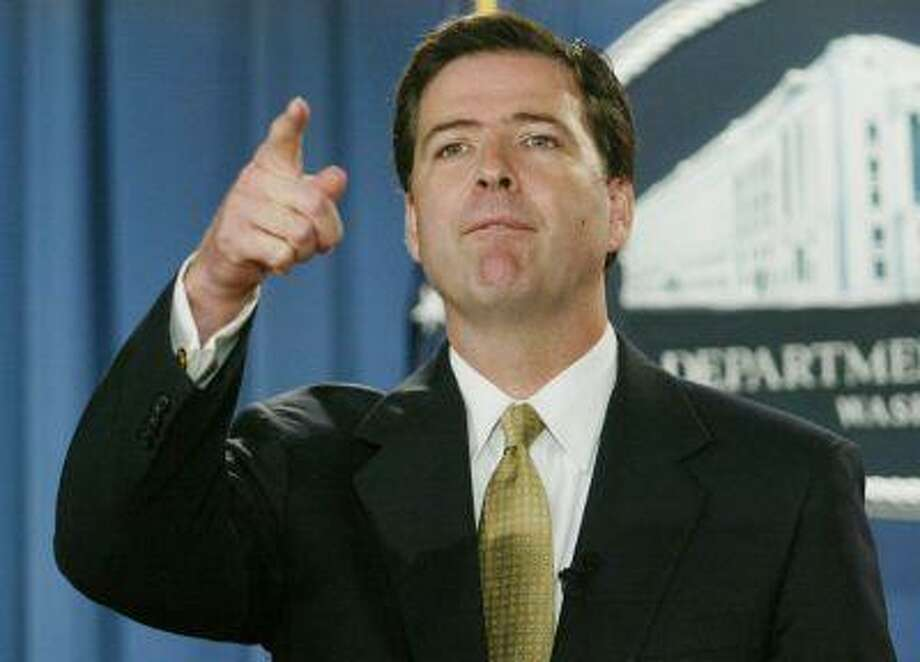 Former U.S. Deputy Attorney General James B. Comey speaks during a news conference in the Justice Department in Washington, in this July 8, 2004 file photo. Photo: REUTERS / X01007