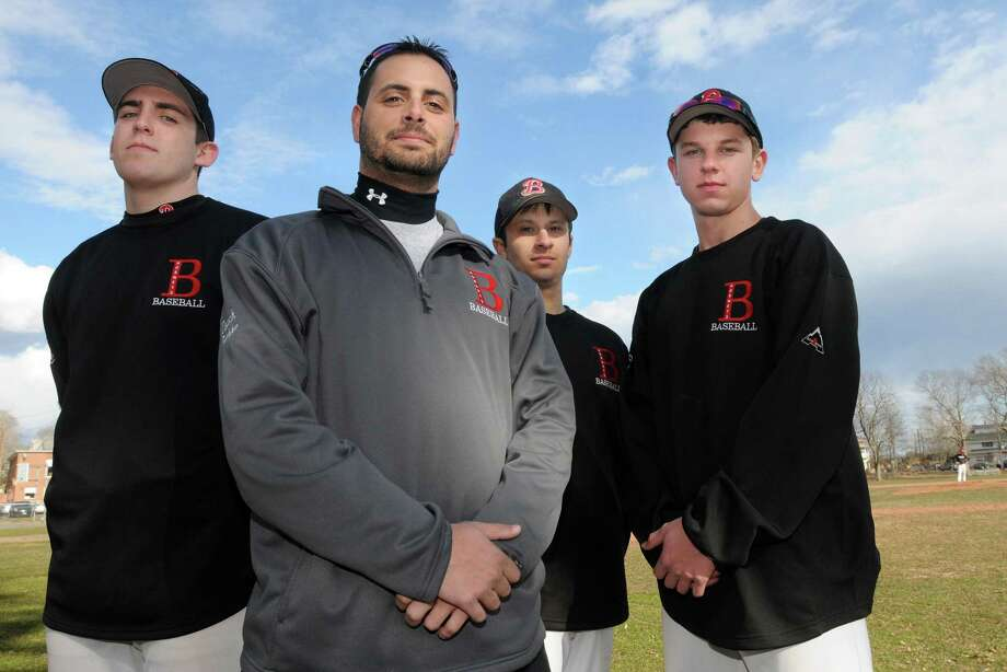 Branford baseball coach Ed Bethke (second from left) and captains, from left to right: Brad Doyle, Ed Bethke. Marc Canzanella, and Rob Petrillo, beat Foran 19-1 on Wednesday. Mara Lavitt/New Haven Register